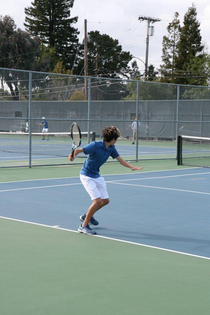 Playing on the 2019 Varsity Los Altos High School tennis team as a freshman.