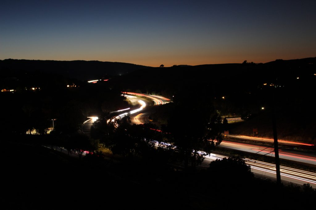 A photo of the freeway at night.