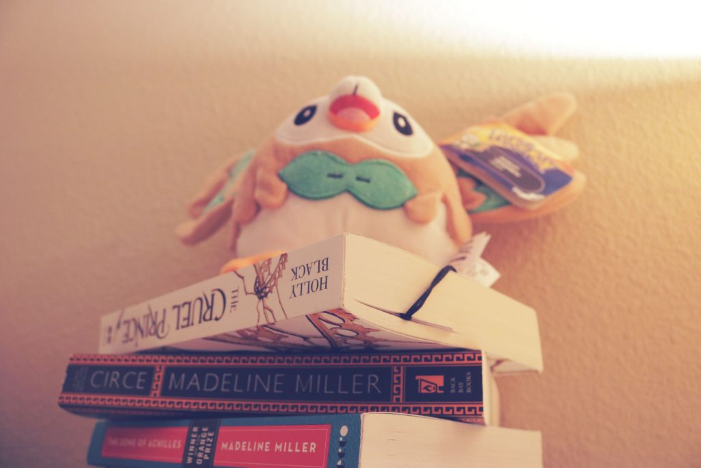 """A Rowlet plushie on a stack of books for the theme of """"Serenity""""."""